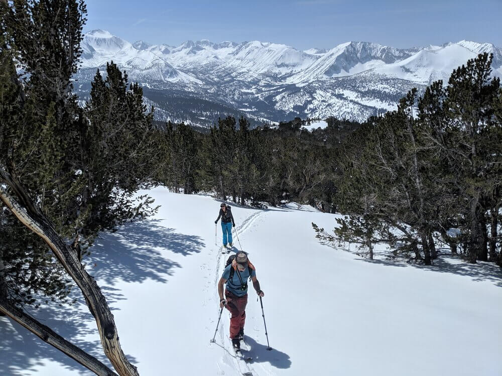 Skiing on a guided backcountry skiing tour in Mammoth Lakes